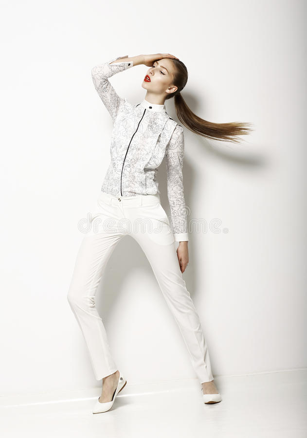 Free Contemporary Clothing Design. Modish Woman In White Blouse And Pants. Fashion Stock Photography - 30375132