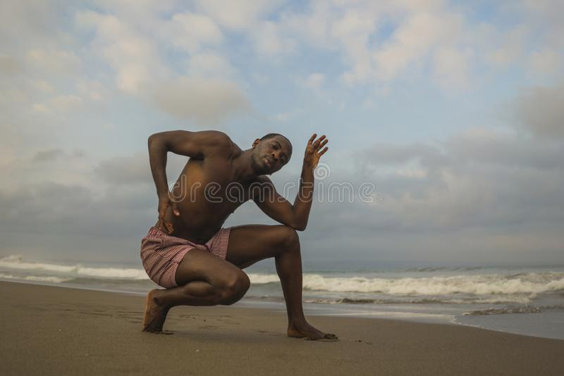 Contemporary dance choreographer and dancer doing ballet beach workout . a young attractive and athletic black African American royalty free stock photography