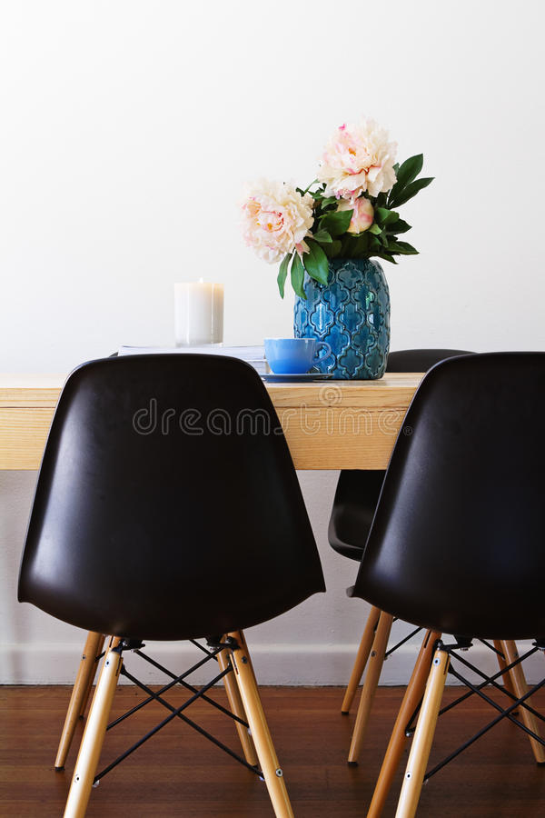 Contemporary dining table and retro chairs. Contemporary interior dining table and retro chairs royalty free stock images