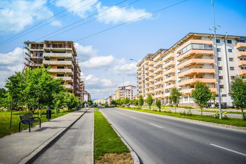 Contemporary european complex of residential buildings with new modern block buildings, green space and big boulevard Dem royalty free stock image