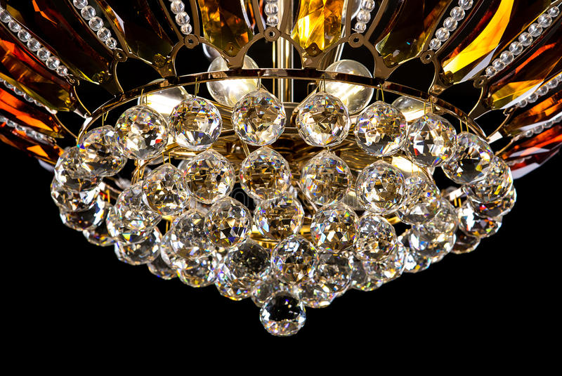 Contemporary gold chandelier isolated on black background crystal download contemporary gold chandelier isolated on black background crystal chandelier decorated amber crystals close aloadofball Gallery