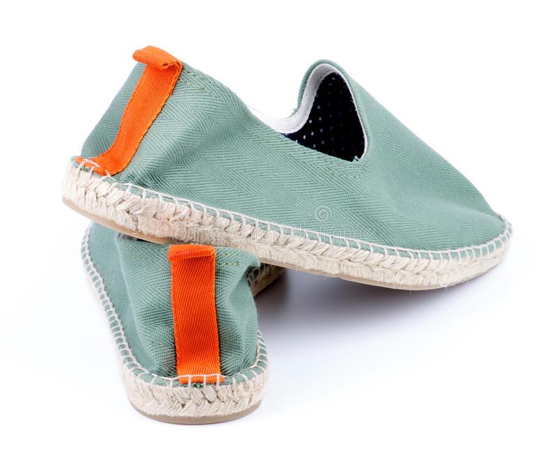 Contemporary Green Espadrilles. Contemporary Light Green Espadrilles with Polka Dot Lining and Orange Facing closeup on White background stock photos