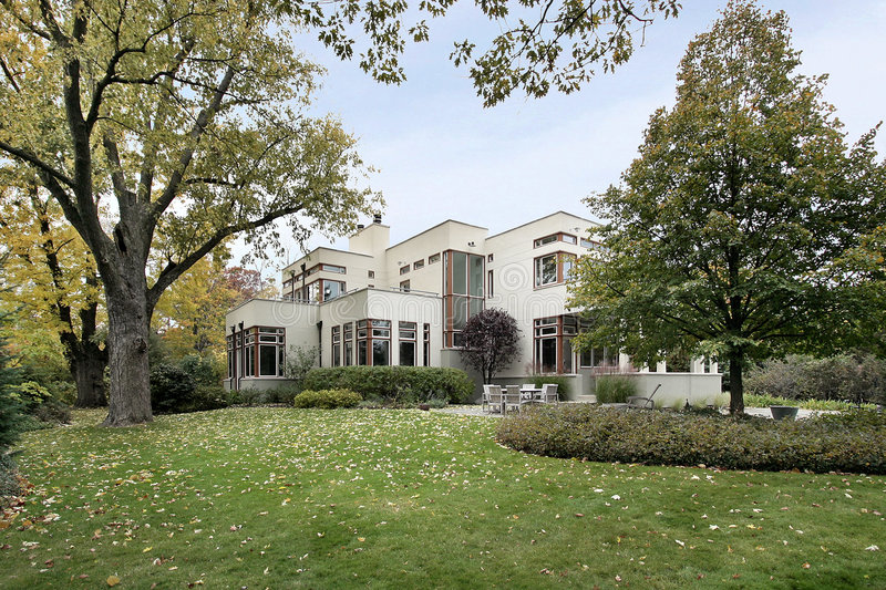 Contemporary home in fall. With large lawn stock images