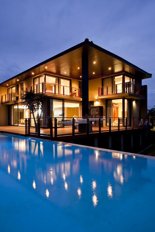 Contemporary home with pool reflection. Taken at dusk stock photos