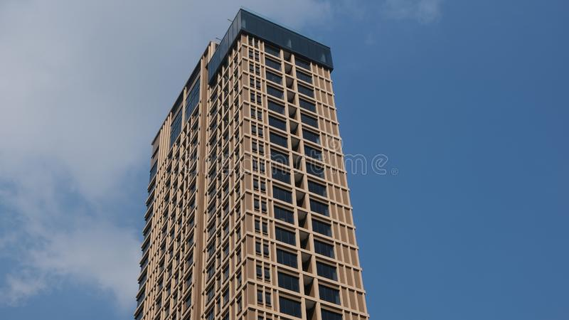 Contemporary hotel Sindhorn Midtown Hotel Bangkok. Soars into blue sky on December 21, 2019 in the Thai capital royalty free stock photos