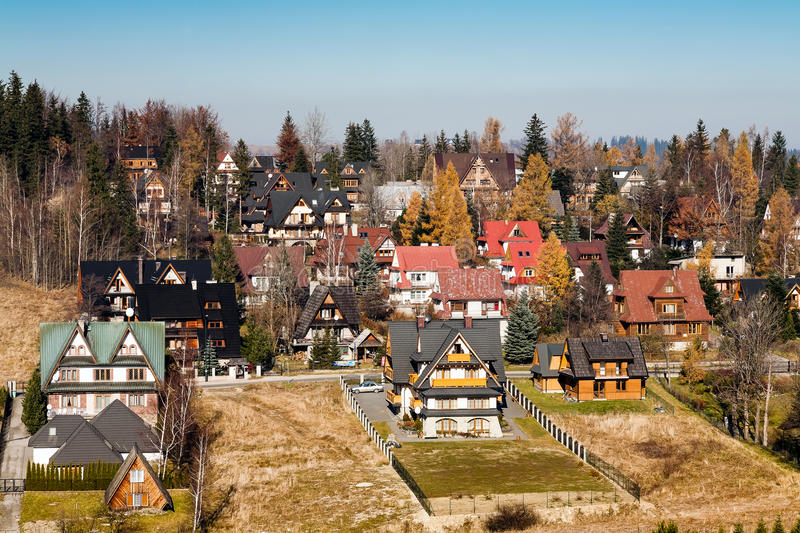 Contemporary houses in Zakopane. ZAKOPANE - AUGUST 11: Contemporary houses located between districts Antalowka and Koziniec usually offering hospitality rooms stock images