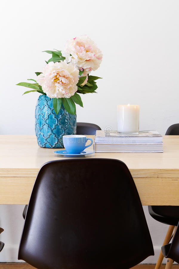 Contemporary interior dining table with cup and white candle stock images