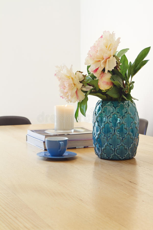 Contemporary interior dining with vase and flowers. Contemporary interior dining with vase flowers and coffee cup royalty free stock photo