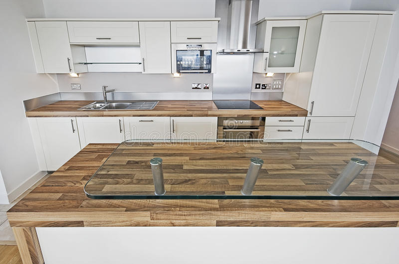 Contemporary kitchen with breakfast bar royalty free stock photos