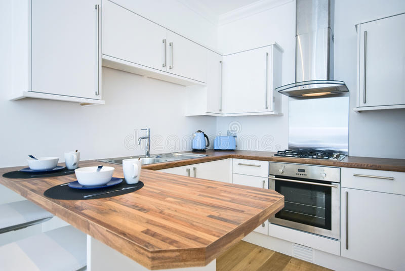 Contemporary kitchen with a breakfast bar royalty free stock image