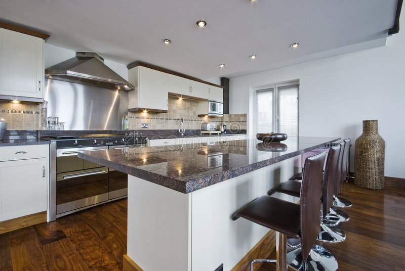 Contemporary kitchen with a breakfast bar royalty free stock photos