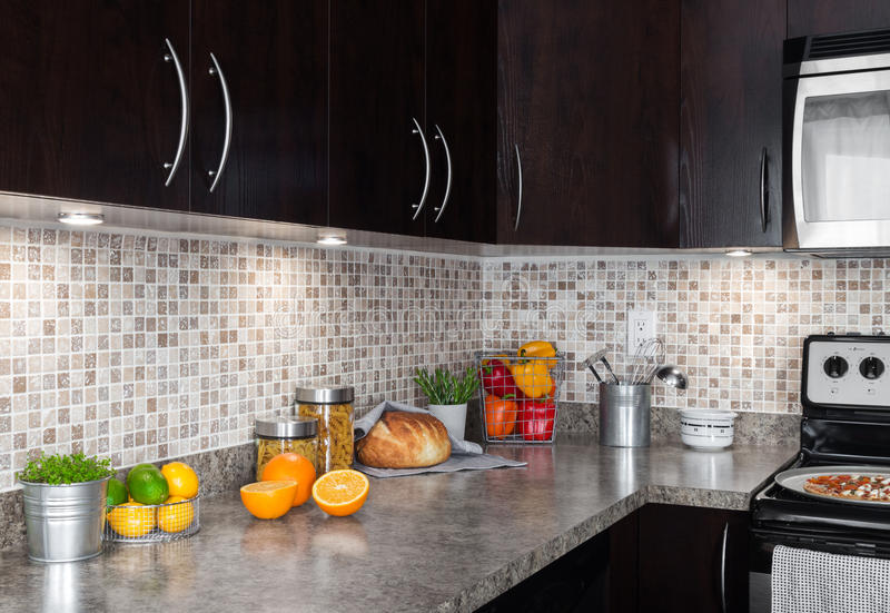 Contemporary Kitchen With Food Ingredients On Countertop Royalty Free Stock Photography