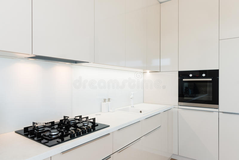 Contemporary kitchen interior. Interior of contemporary kitchen with built in appliances stock photos