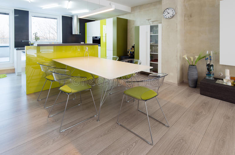 Contemporary kitchen interior. Modern kitchen interior in green and white color royalty free stock image