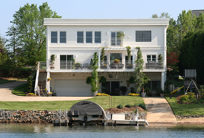 Contemporary Lake Home. White modern contemporary lake front home royalty free stock image