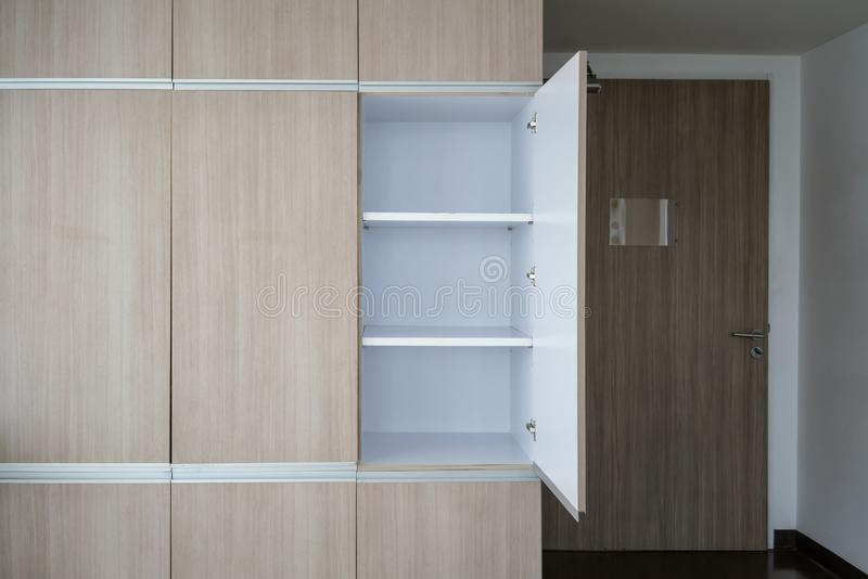Contemporary modern fully fitted wooden storage cabinet royalty free stock photos
