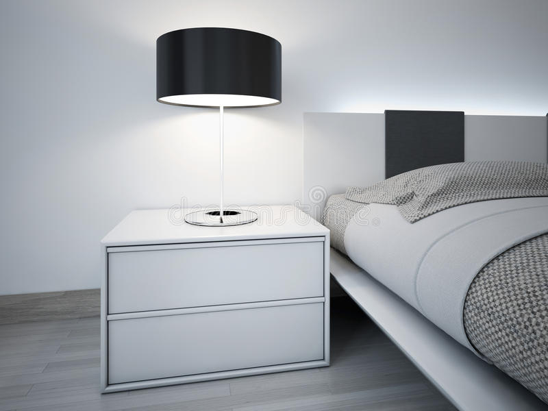 Contemporary monochrome bedroom design. Stylish bedside table near bed with neon lights behihd headboard. Lamp with black lampshade royalty free stock images