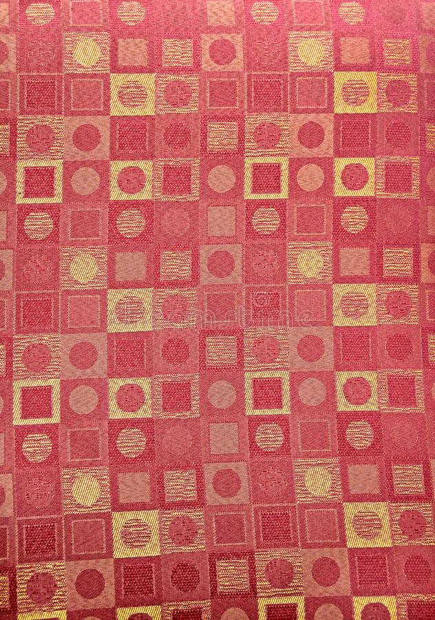 Contemporary pattern fabric. Photo of red and gold contemporary pattern with squares and spots ideal for backgrounds etc stock image