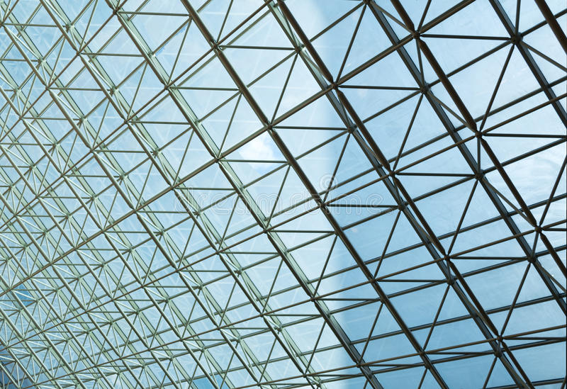 Contemporary steel structure and transparent glass roof stock image