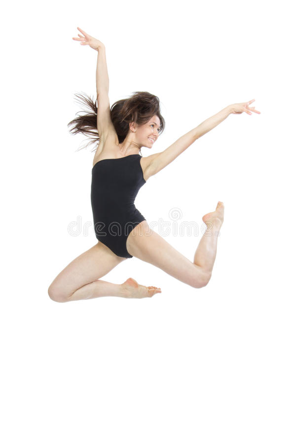 Contemporary style woman ballet dancer jumping. Slim jazz modern contemporary style woman ballet dancer jumping isolated on a white studio background royalty free stock images