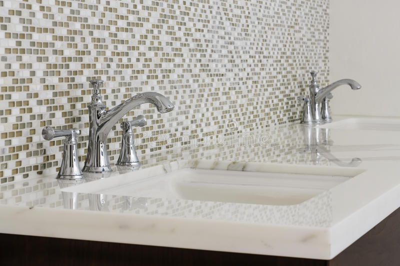 Contemporary twin bathroom sinks and fixtures royalty free stock photography