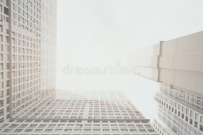 Contemporary white and grey residential skyscraper apartment building. With right angle between housing body, Moscow, bright cloudy day, view from bottom royalty free stock images