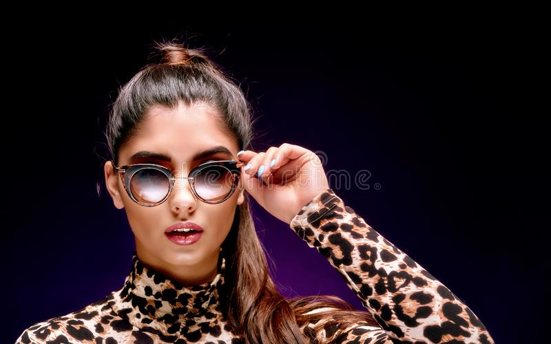 Gorgeous young brunette in sunglasses royalty free stock photos