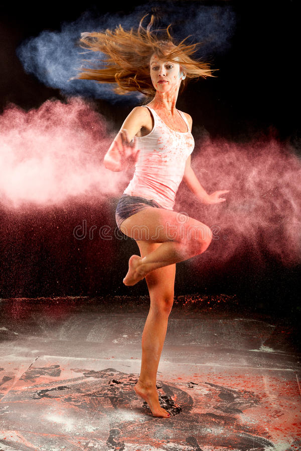 Contemporary dance girl spin pink blue flour royalty free stock photos