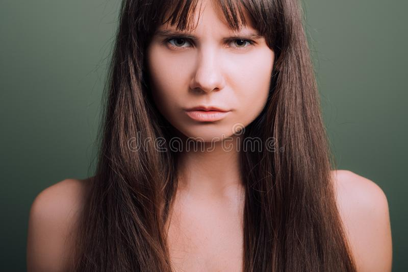 Contemptuous wary insecure emotion girl portrait. Contemptuous looking beautiful girl. Wary facial expression. Closeup portrait of emotional lady stock images