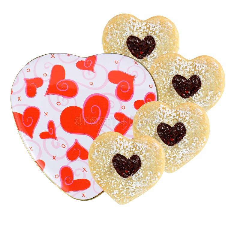 Conteneur en forme de coeur avec des biscuits image libre de droits