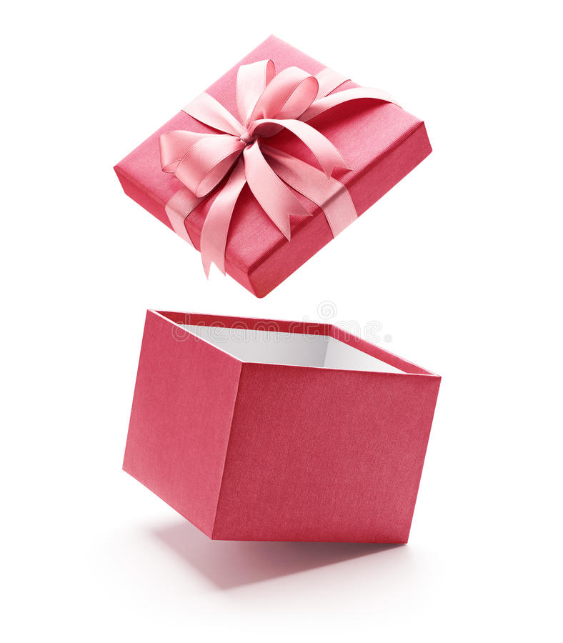 Contenitore di regalo aperto di rosa isolato su bianco fotografia stock