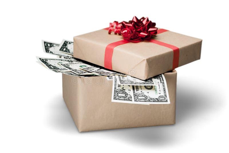 Contenitore di regalo con la banconota dei dollari su fondo fotografia stock libera da diritti