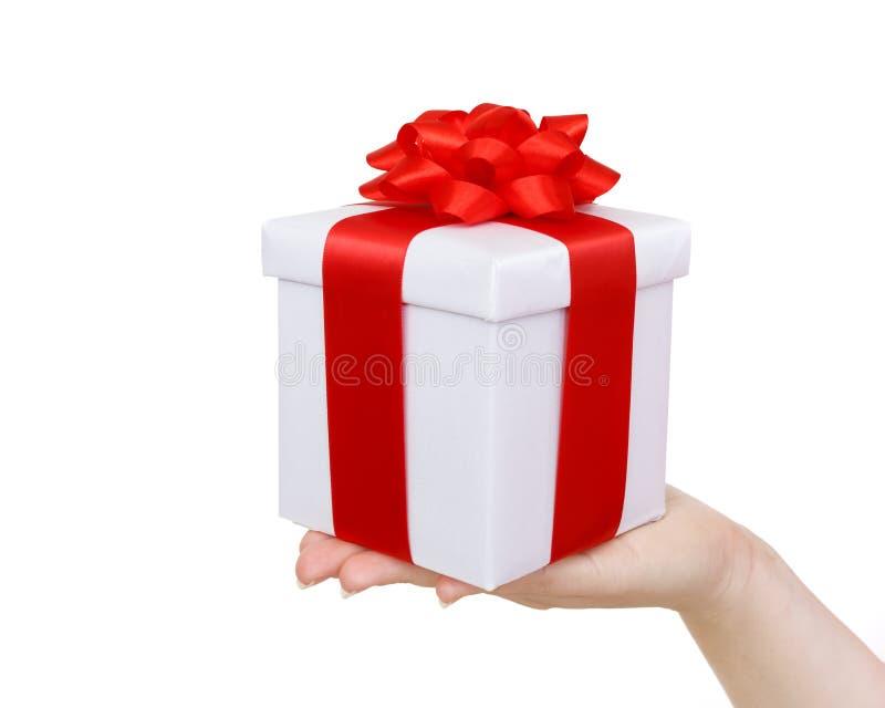 Contenitore di regalo a disposizione fotografia stock