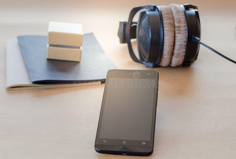 Contenitore di taccuino mobile della cuffia piccolo immagini stock libere da diritti