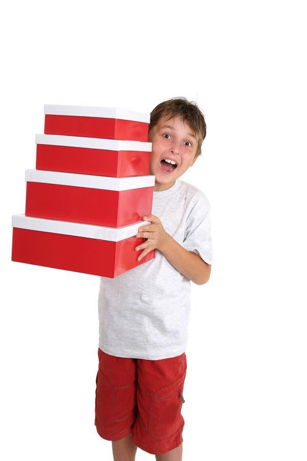 Contenitori di regalo di trasporto del bambino emozionante fotografie stock libere da diritti