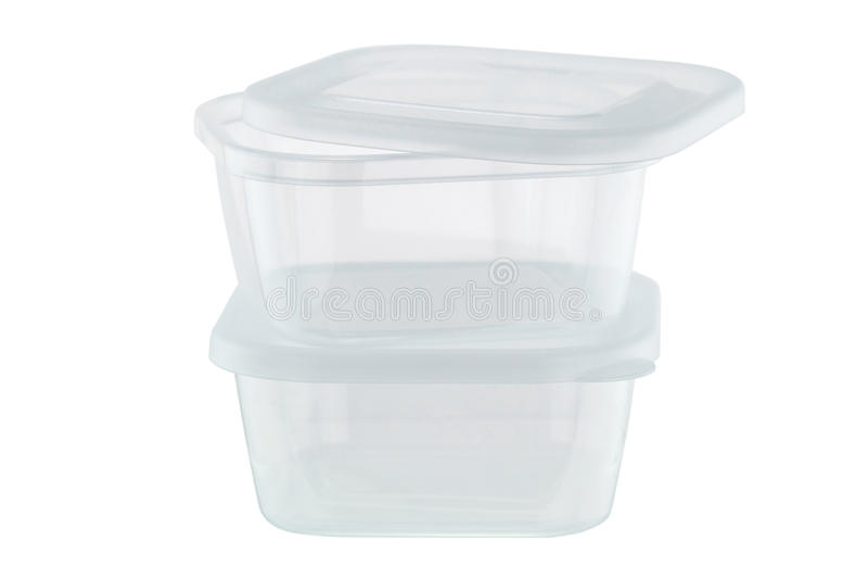 Contenitori di stoccaggio di plastica trasparenti dell'alimento isolati sulle sedere bianche immagine stock
