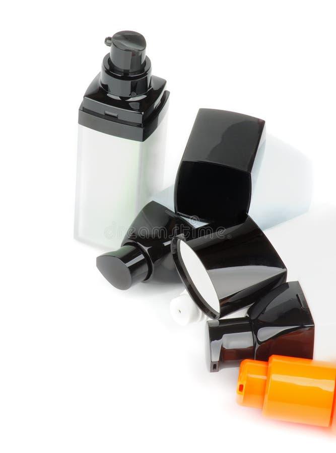 Contenitori facciali dei cosmetici fotografie stock