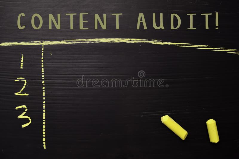 Content Audit! with color chalk. Supported by an additional services. Blackboard concept stock images
