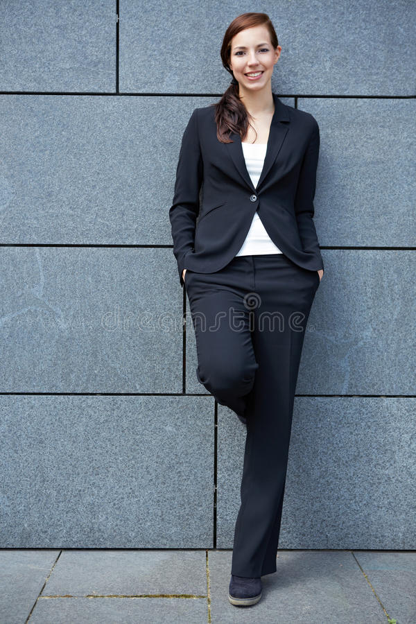 Content business woman in city