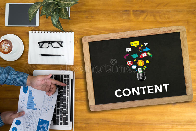 CONTENT CONCEPT. Businessman working at office desk and using computer and objects, coffee, top view, with copy space royalty free stock photos