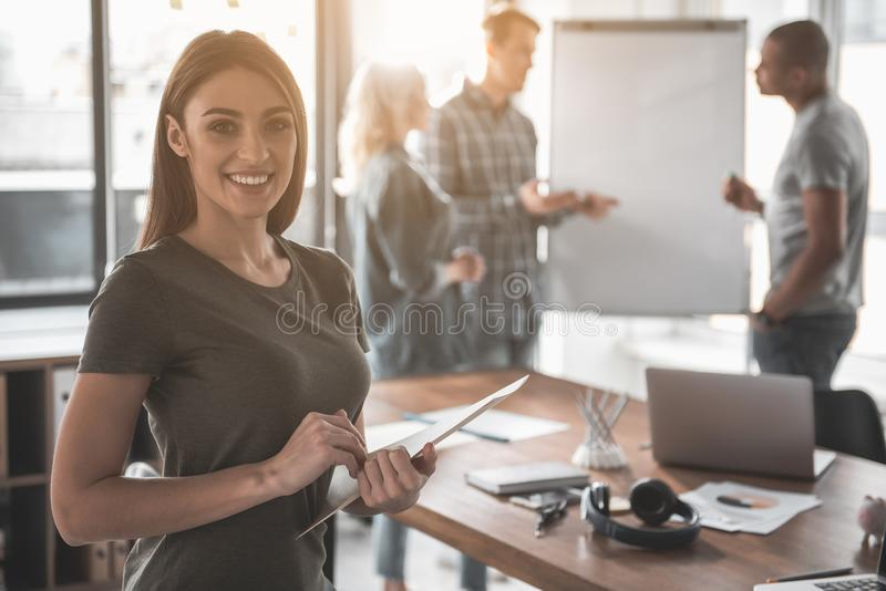 Content girl having her business plan done stock photos