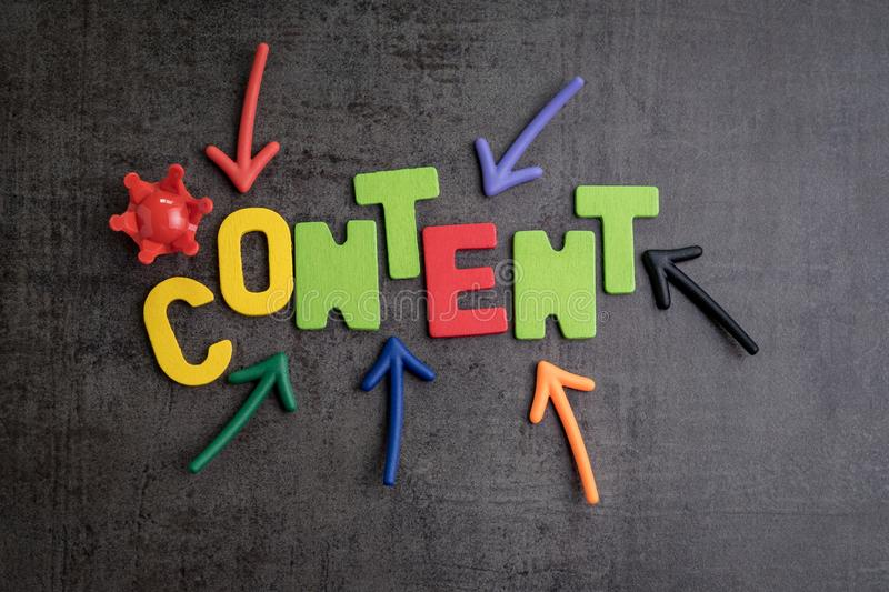 Content is king in brand communication and advertising concept idea, colorful arrows pointing to the word CONTENT at the center. With red crown on black cement royalty free stock images
