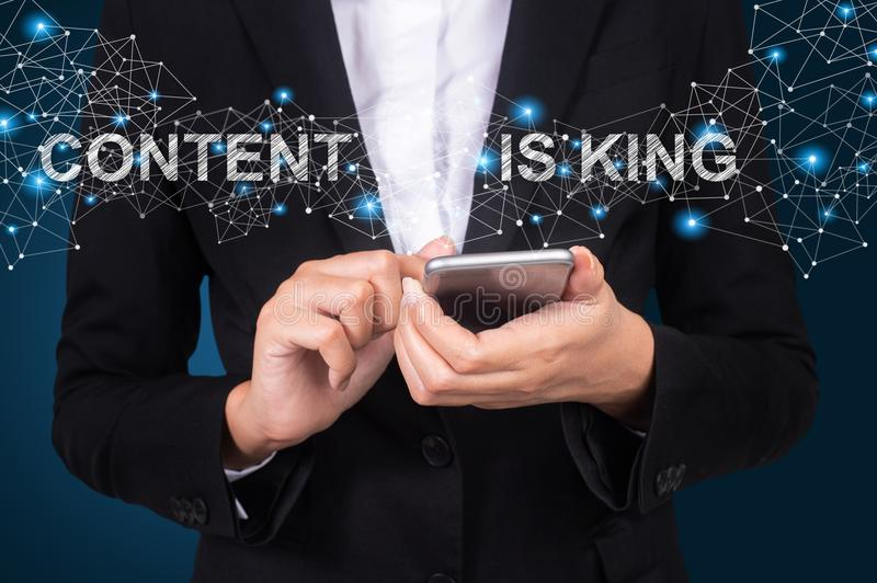 Content Is King concept, Businesswoman using mobile smart phone, Social, media.  royalty free stock photography
