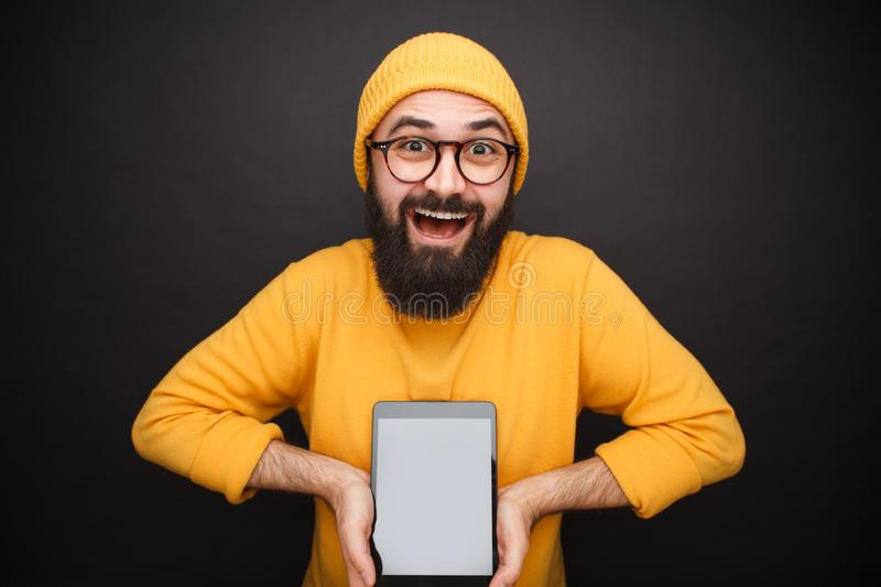 Content man showing modern tablet royalty free stock photo