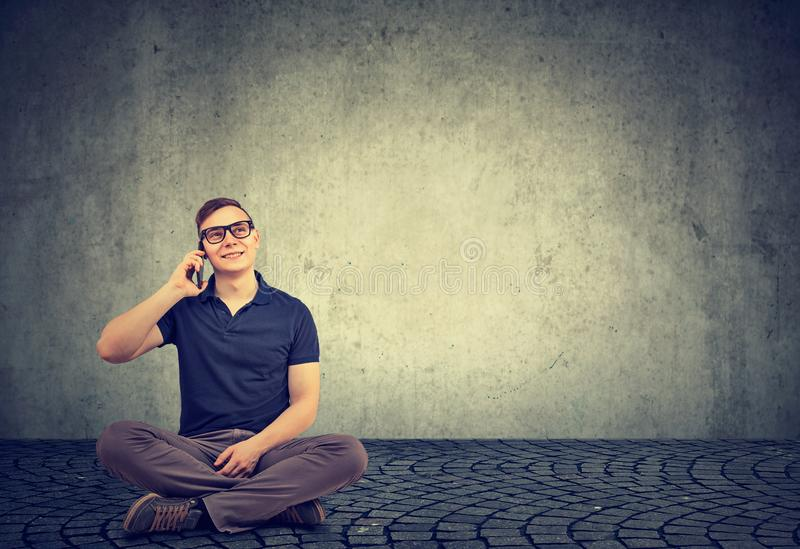 Content man speaking on phone while sitting stock images