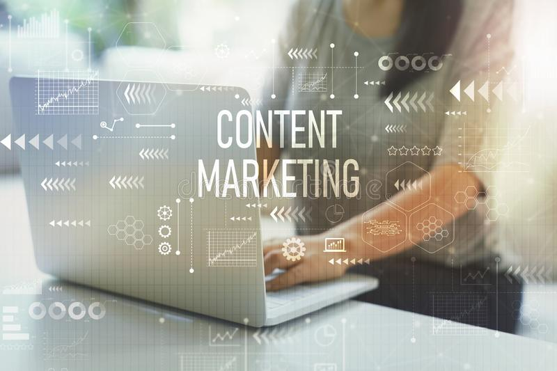 Content marketing with woman using laptop royalty free stock image
