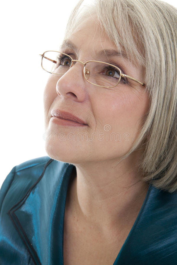 Content mature woman. Mature, attractive Caucasian woman looking off into the distance royalty free stock photos