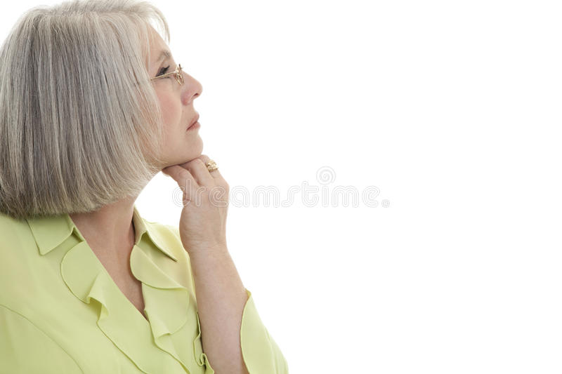 Content mature woman. Mature, attractive Caucasian woman looking off into the distance stock image