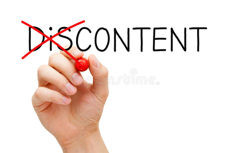 Content Not Discontent Concept. Hand turning the word Discontent into Content with red marker isolated on white stock photography