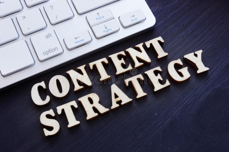Content strategy from small letters and keyboard. SEO concept royalty free stock image